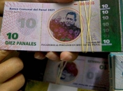 Pobres venezolanos lanzan moneda local